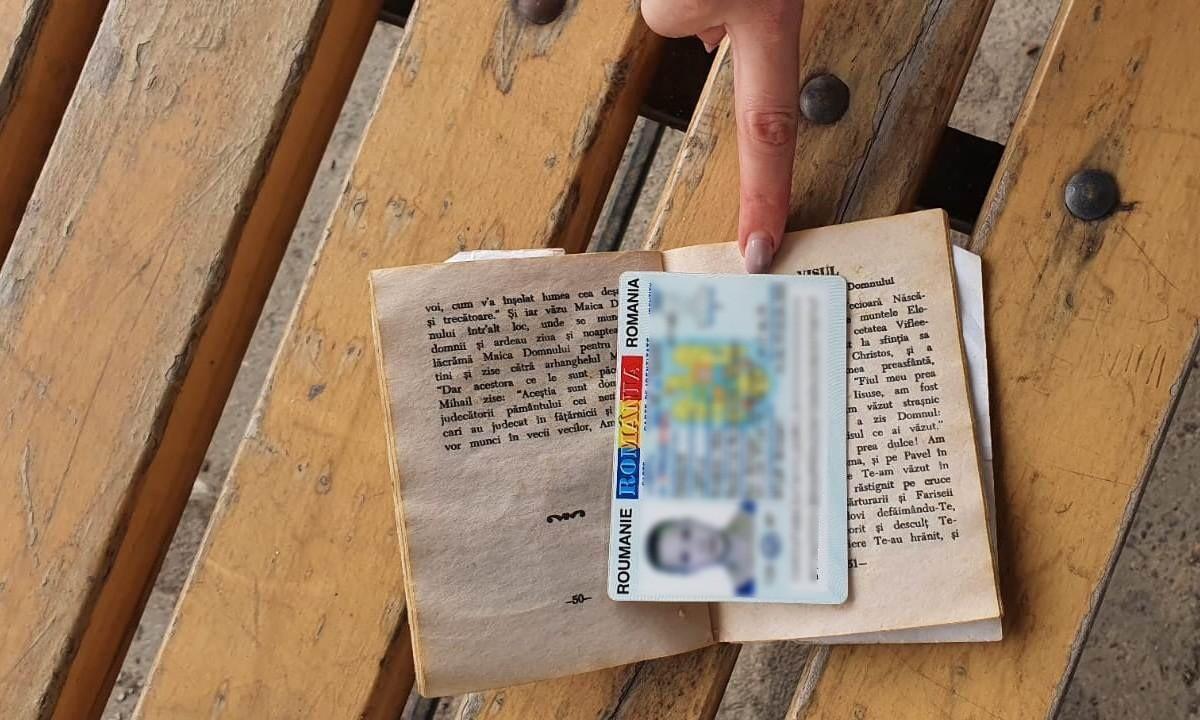 FOTO // O moldoveancă de 20 de ani și-a ascuns buletinul românesc fals în cartea cu rugăciuni, dar a fost găsit de polițiști